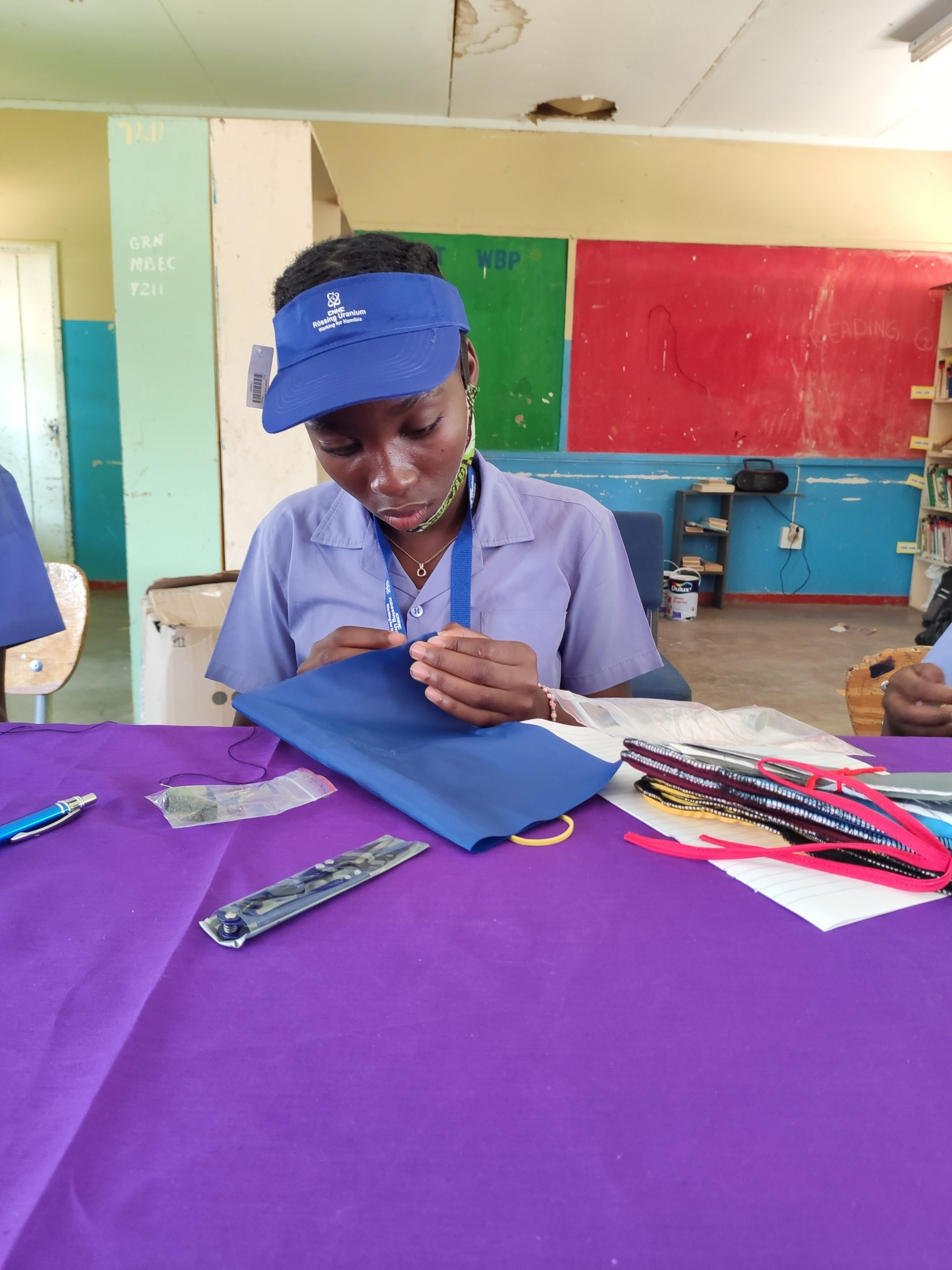 a young girl empowered to make her own reusable sanitary pad