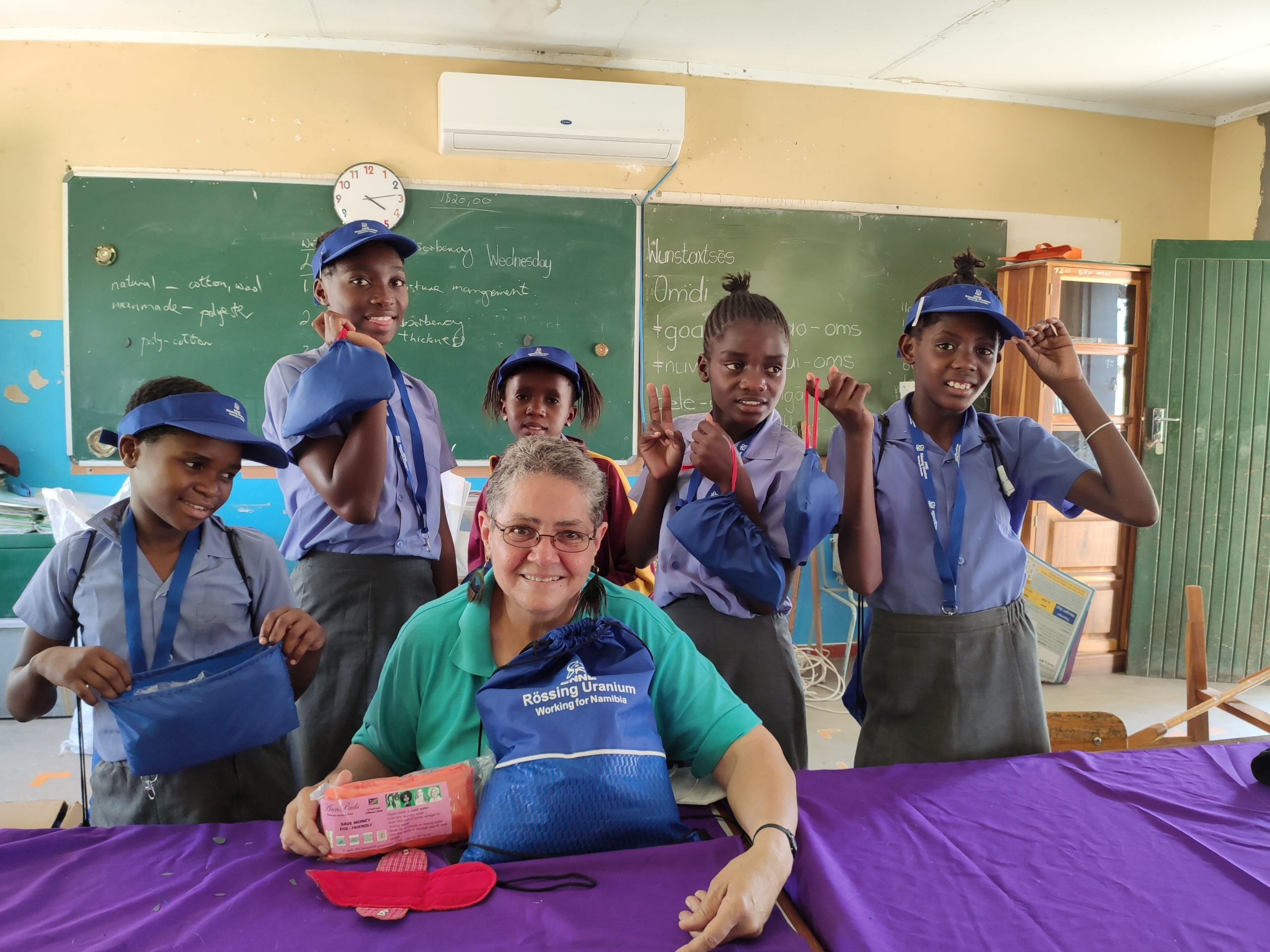 young females from the Willem Borchard primary school are taught to make their own reusable sanitary pads